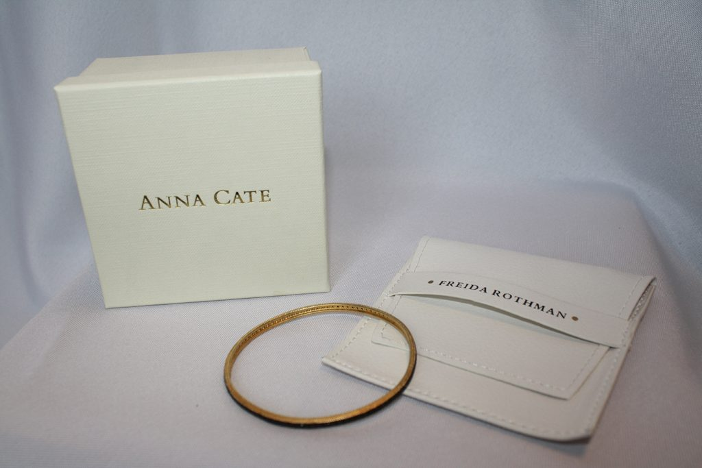 Black and Gold Freida Rothman Eternity Bangle  donated by Anna Cate Jewelry