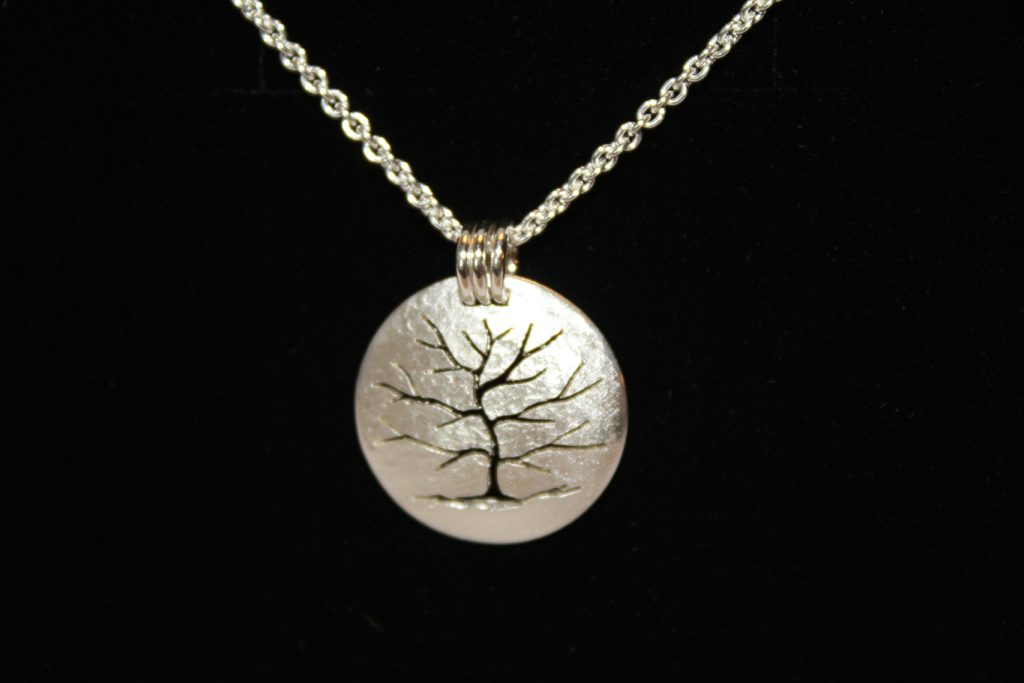 Huntsville's own Connie Ulrich donated a stunning tree pendant with silver cable necklace!