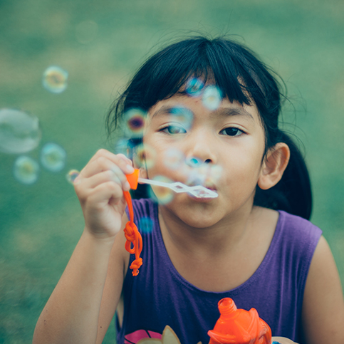 asian girl blowing bubbles